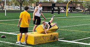 Iowa youth football clinic lets junior Hawkeyes emulate thei